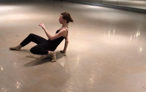 Senior Katelyn Cummings rehearses solo in a dance studio to breakdown each movement.