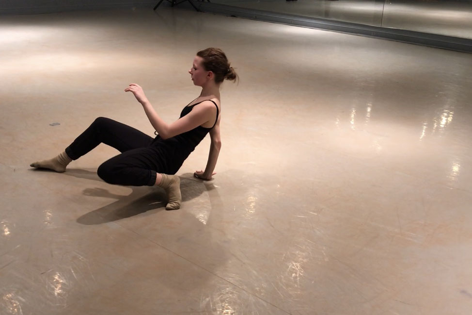 Senior Katelyn Cummings rehearses solo in a dance studio to breakdown each movement.