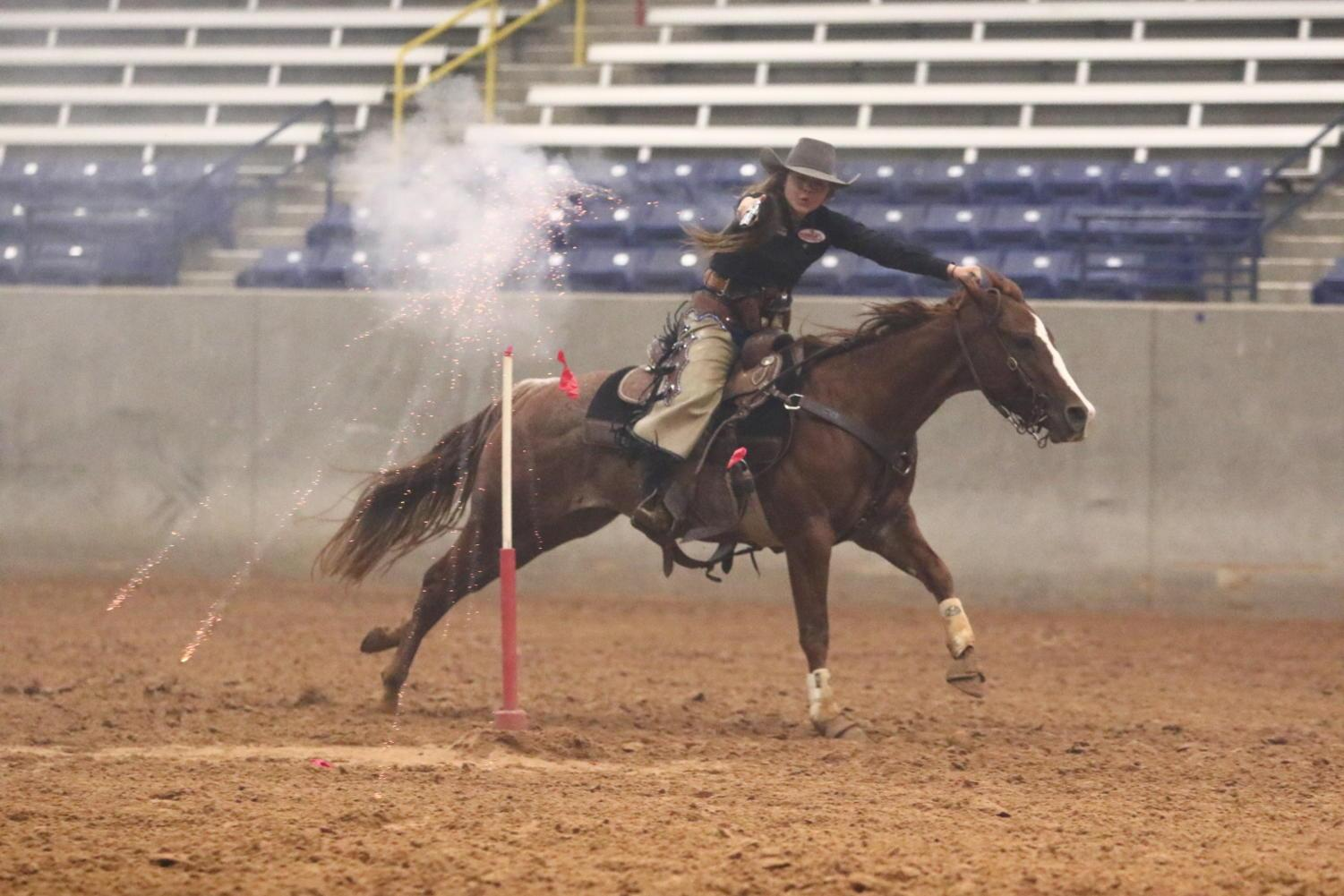 Former senior Lindsey Farrell chose online schooling to allow more time to practice her riding and shooting skills.