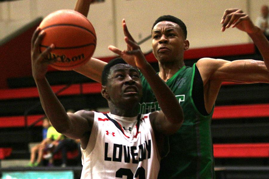 Junior+Jonathan+Lawrence+attempts+a+layup+as+he+is+blocked+by+a+Mesquite+Poteet+player.