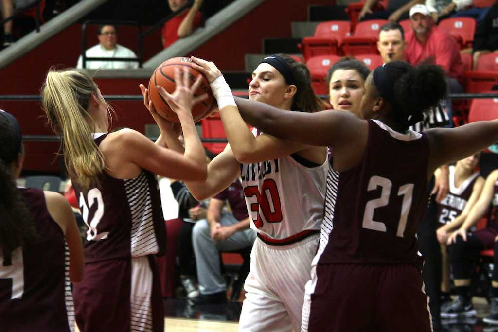 Junior Alexandra Brungardt is fouled as she pulls up her arms to shoot.