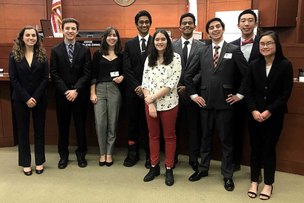 The Mock Trial team poses for picture during the regional finals. Pictured from left to right are Polly Roth, Mikey Franks, Maddie Roth, Nick Dodda, Amelia Flinchbaugh, Abel Thomas, Zach Brown, Brandon Su, and Sydney Wong.