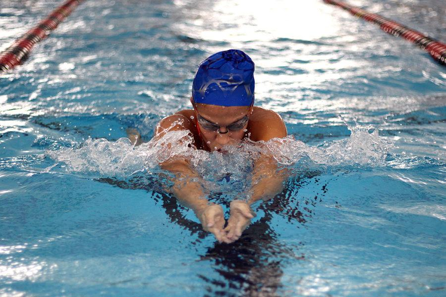 Senior Sloan Carevic practices her breaststroke ahead of the regional competition.