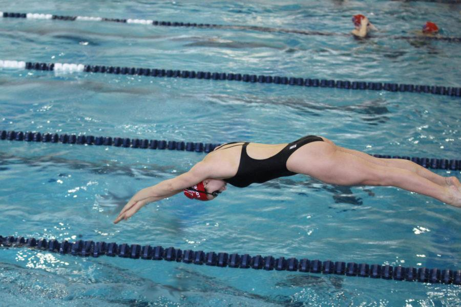 Senior Sloan Carevic dives off the block during warm-ups.