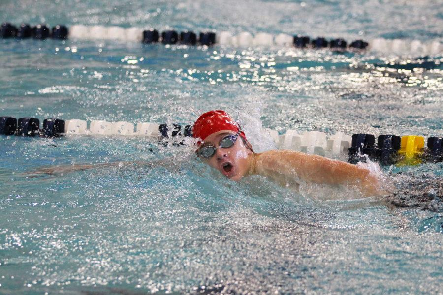 Freshman Max Mueth swims the freestyle in his first competition of the day.