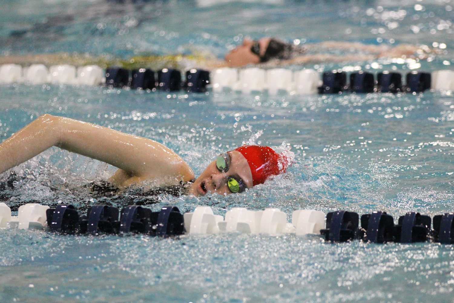 Senior+Sydney+Myers+swims+the+freestyle+at+the+regional+meet.
