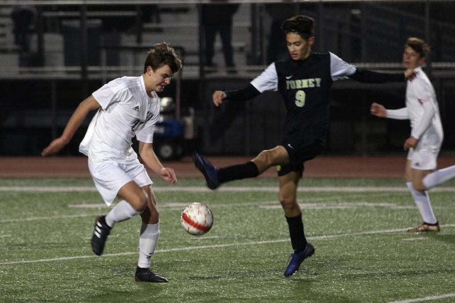 Junior Max Pabin attempts to seize possession from an opposing forward.