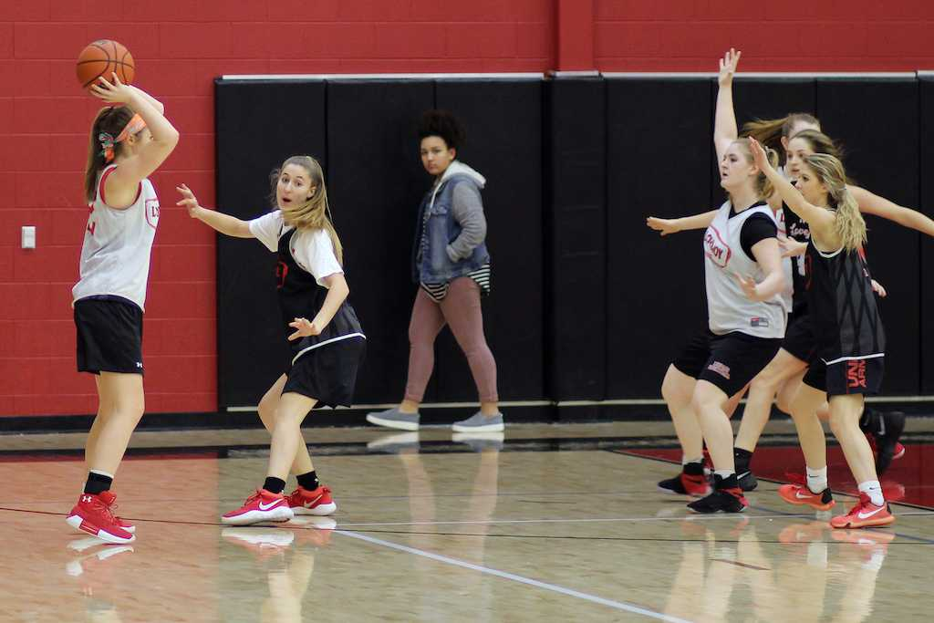 Junior Carson McFadden guards a teammate while trying to pass to senior Ireland Miller.