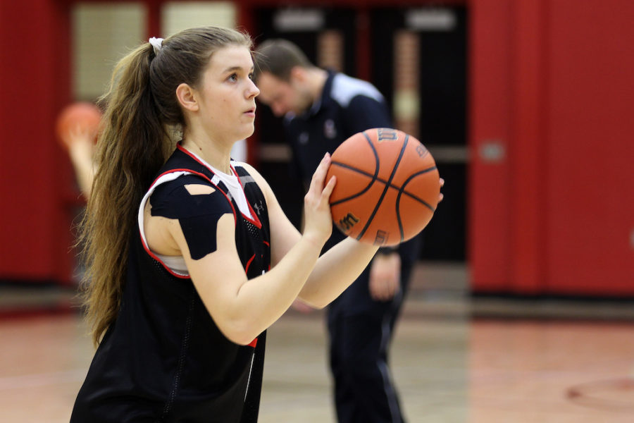 Freshman Julia Brochu measures up for a free throw in practice.
