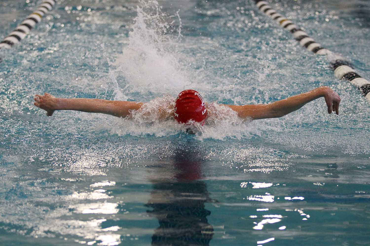 James Vaughn races at the regionals swim meet. He is swimming the butterfly portion of the 200 individual medley.