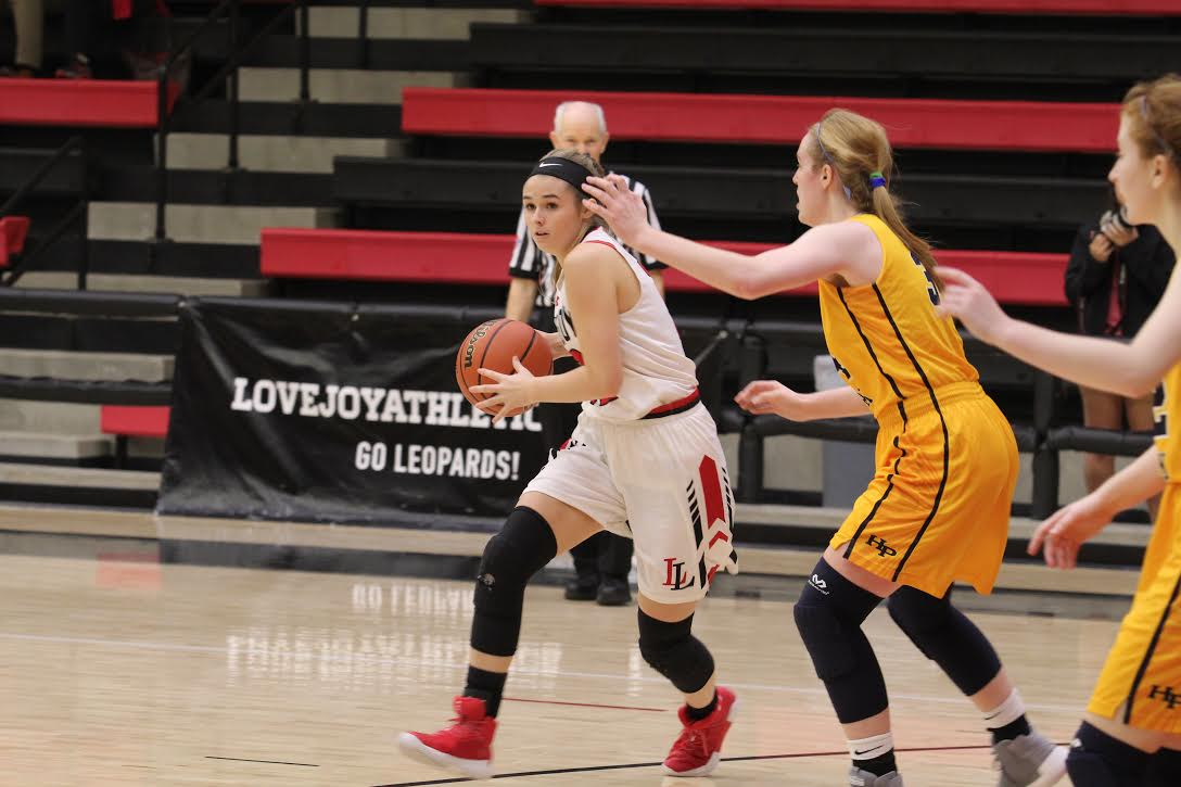 Senior Meredith Welch looks to distribute the ball to a teammate on the perimeter.