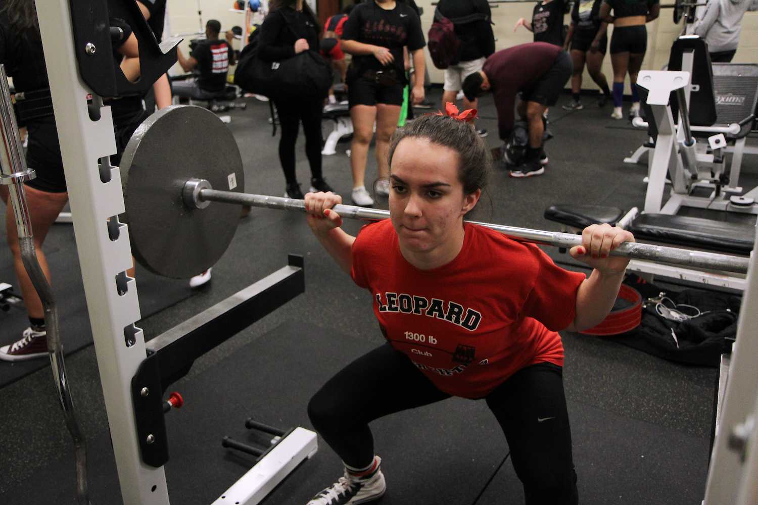 Junior Ally Carraway performs the squat during practice.
