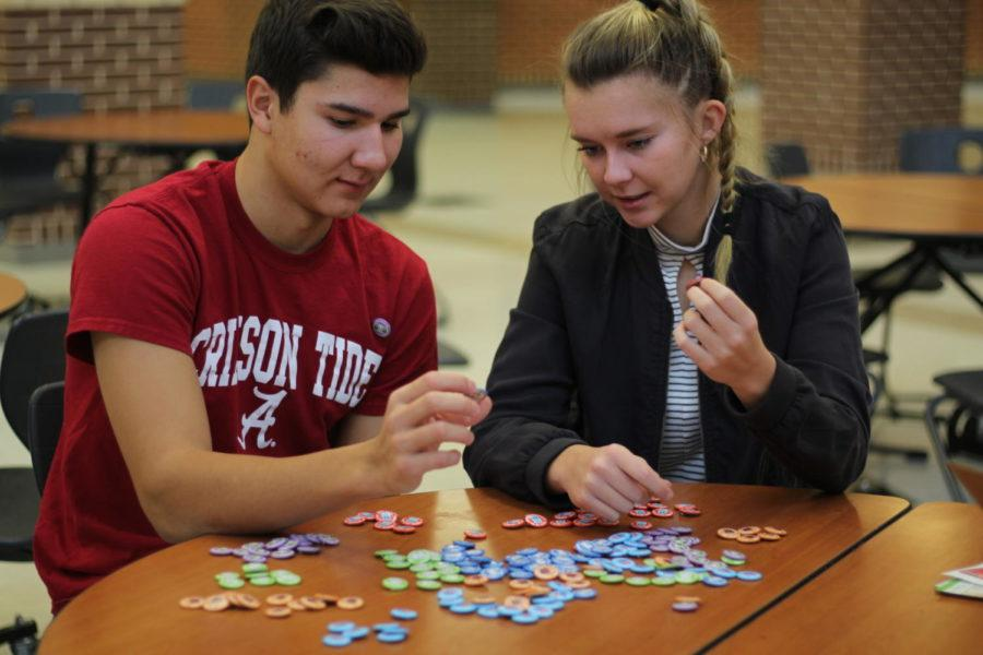 Seniors Turner Thompson and Parker Johnson sort buttons in preparation for