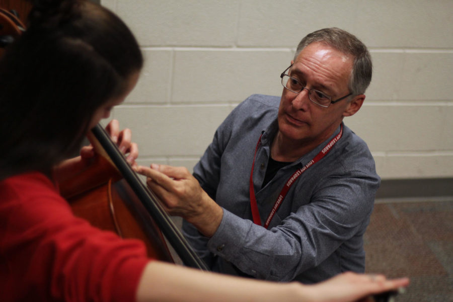 Cello instructor Phillip Taggart teaches students in the school. Students have said they learn life lessons from him, and he is their good friend.