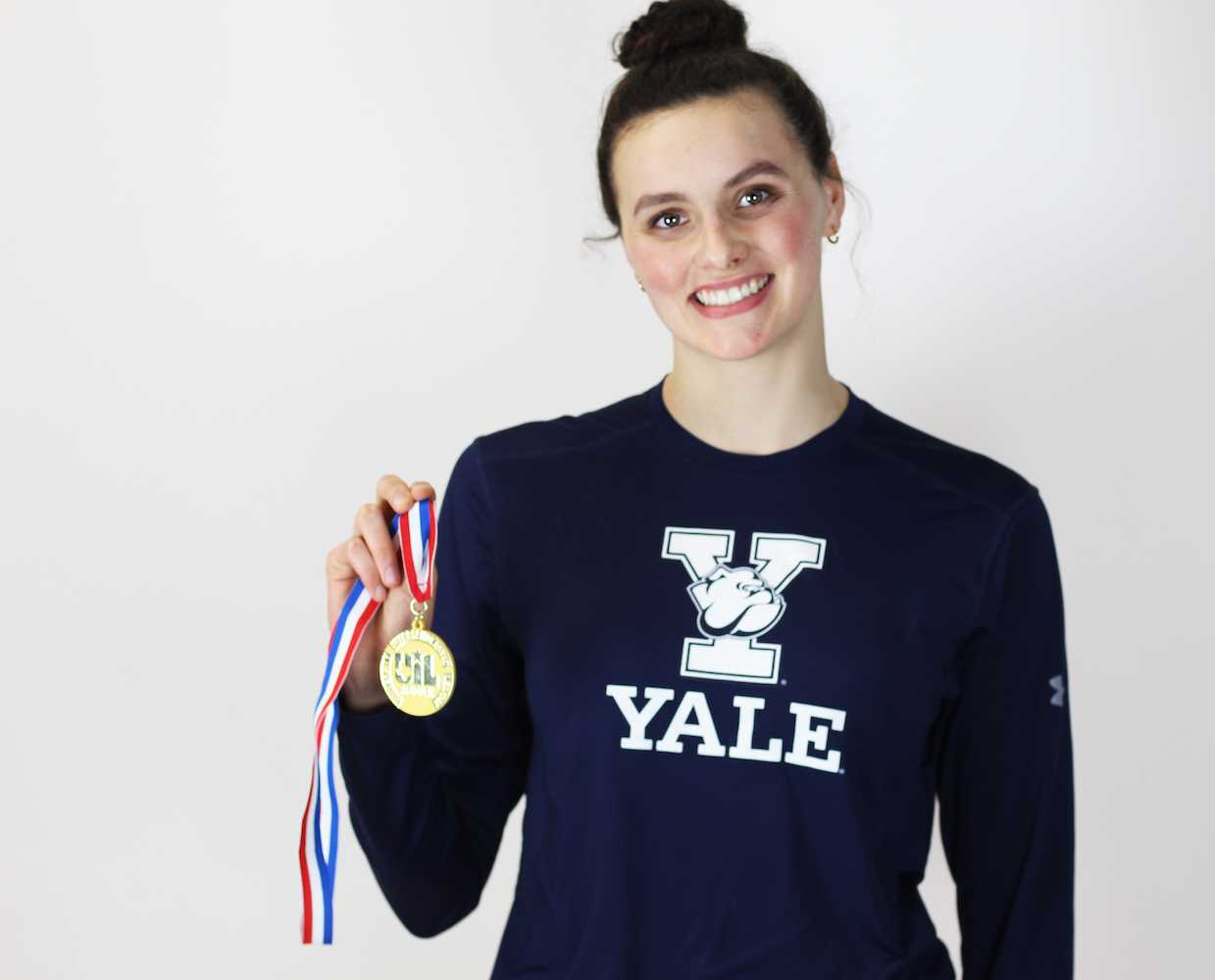 Senior Raime Jones, a future Yale student and swim team member, poses with her medal for winning the 500 meter freestyle at the 5A state meet.