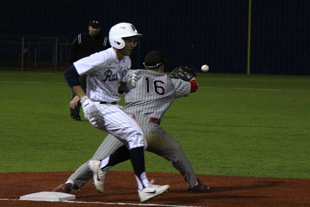 Junior Micheal DiFiore opens his glove for the catch as the Wylie East Raider crosses the base.