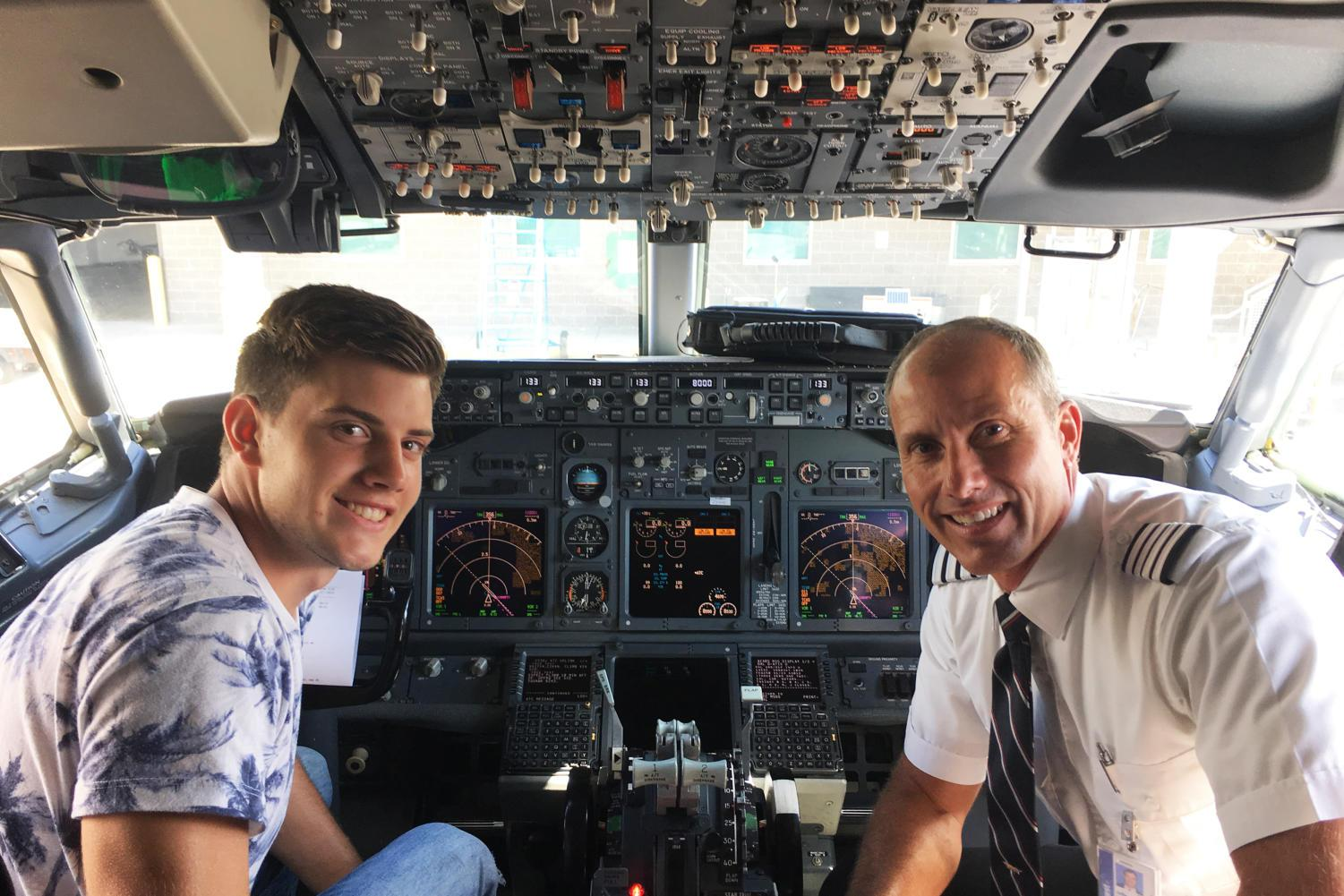 Matt Harris (left) and his father Jeff (right) sit the cockpit of a plane piloted by Jeff.