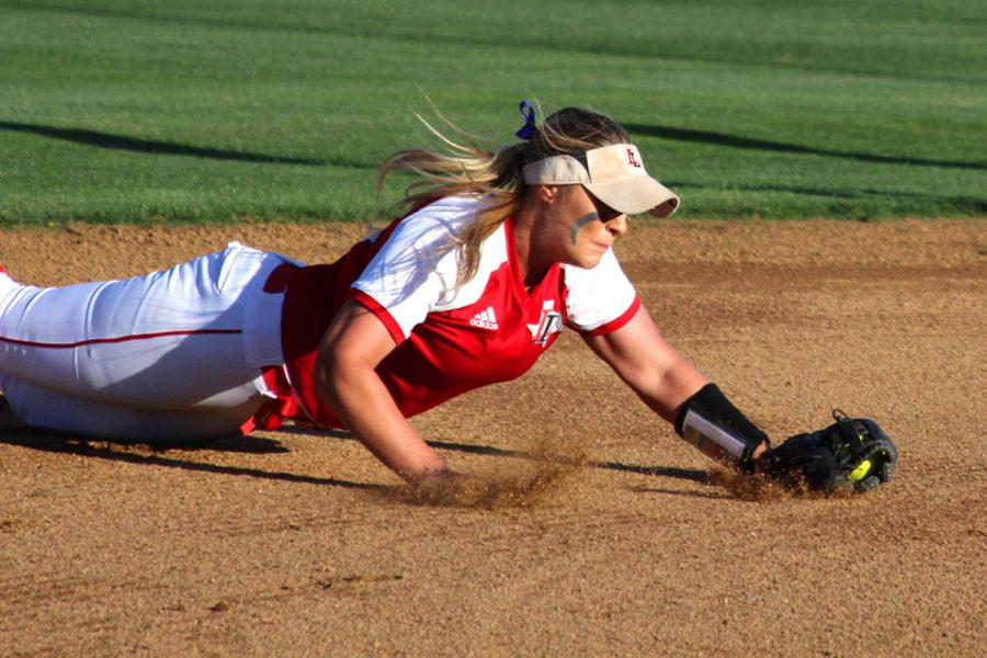 Senior Alyssa Difiore makes a diving play to keep the ball in the infield.