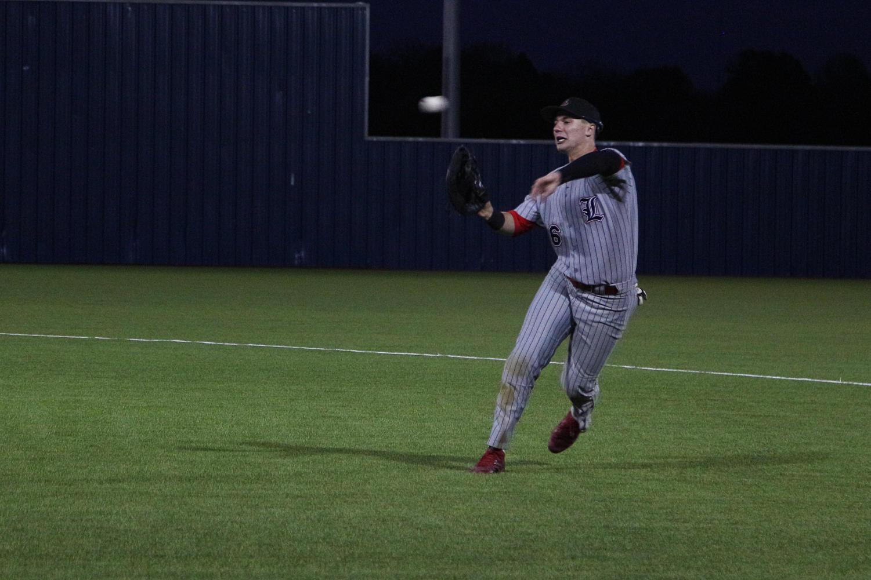 Junior Michael Difiore hurls the ball across the diamond.