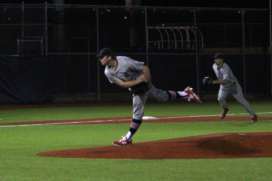 Senior Nathan Fallon delivers a pitch from the windup.