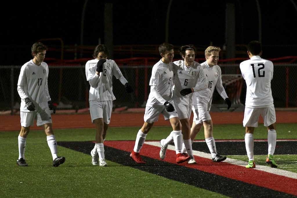 The Leopards celebrate after senior Gavin George scores a goal against the Forney Jackrabbits.