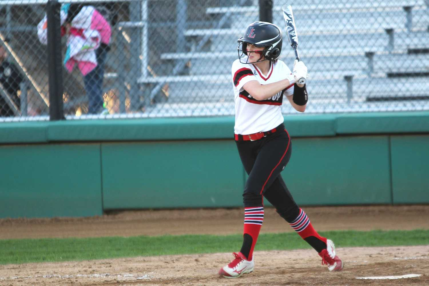 Sophomore Mackenzie Mitchell looks at her line drive.