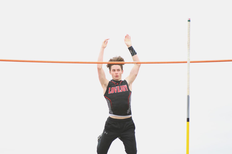 Sophomore Michael DesJardins takes flight during pole vault.