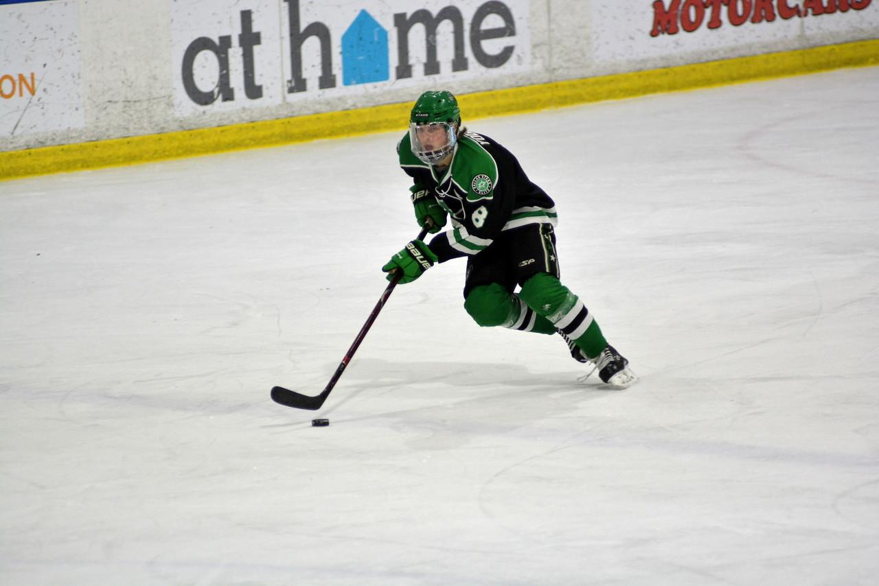 Sophomore Chase Yoder enters the zone in a game with the Dallas Stars 16UAAA team.