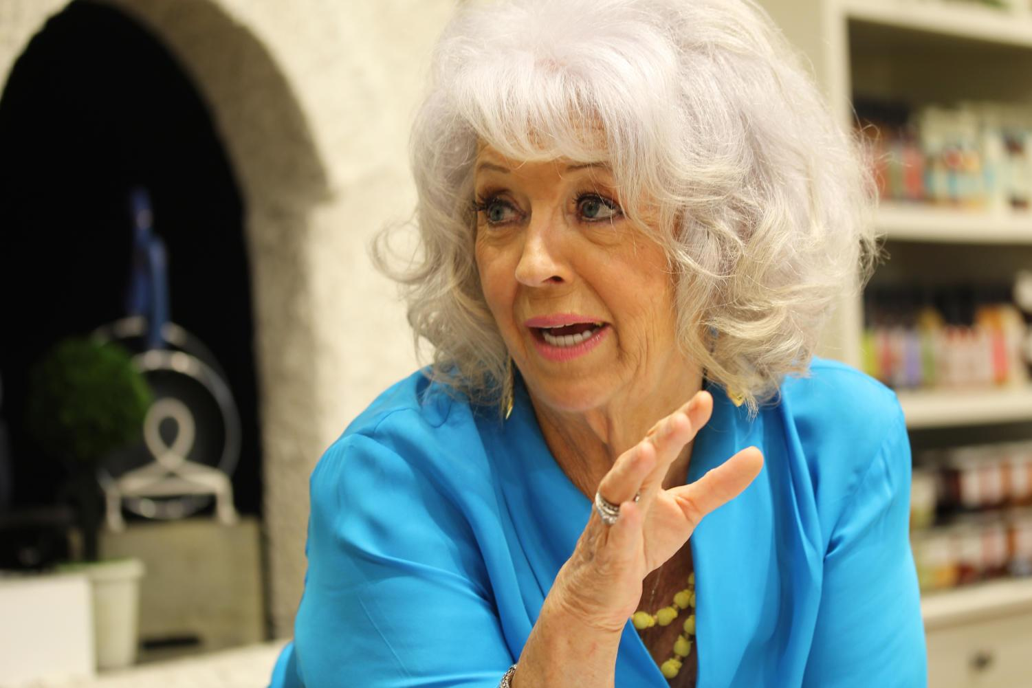 Famous chef Paula Deen answers a question in her new restaurant located in the Villages of Fairview.