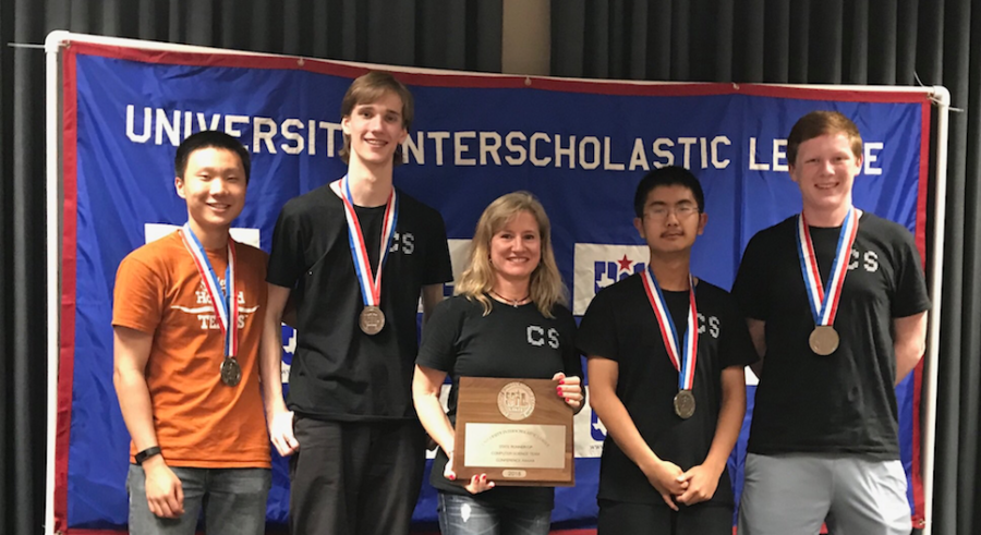 The computer science team poses on the podium with their second place trophy.