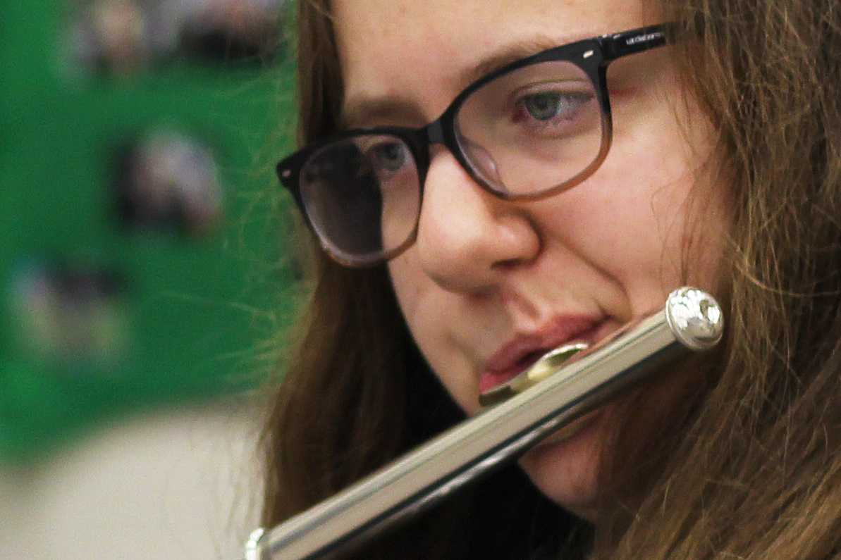 Sophomore Kaileigh Smith practices the flute in preparation for the contest