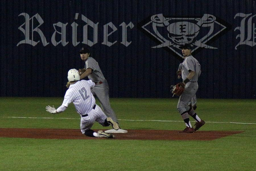 Sophomore Matt Piccirillo looks to turn a double play after receiving a feed from junior Luke Finn.