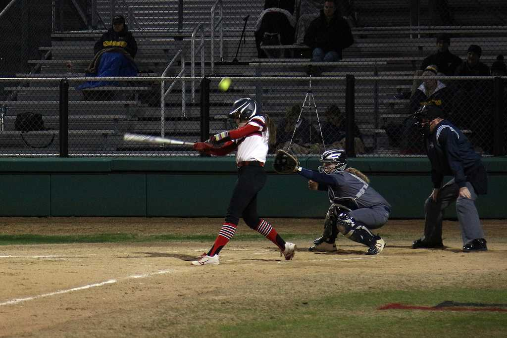 Junior Delaney Dicristofaro takes a swing at a fastball.