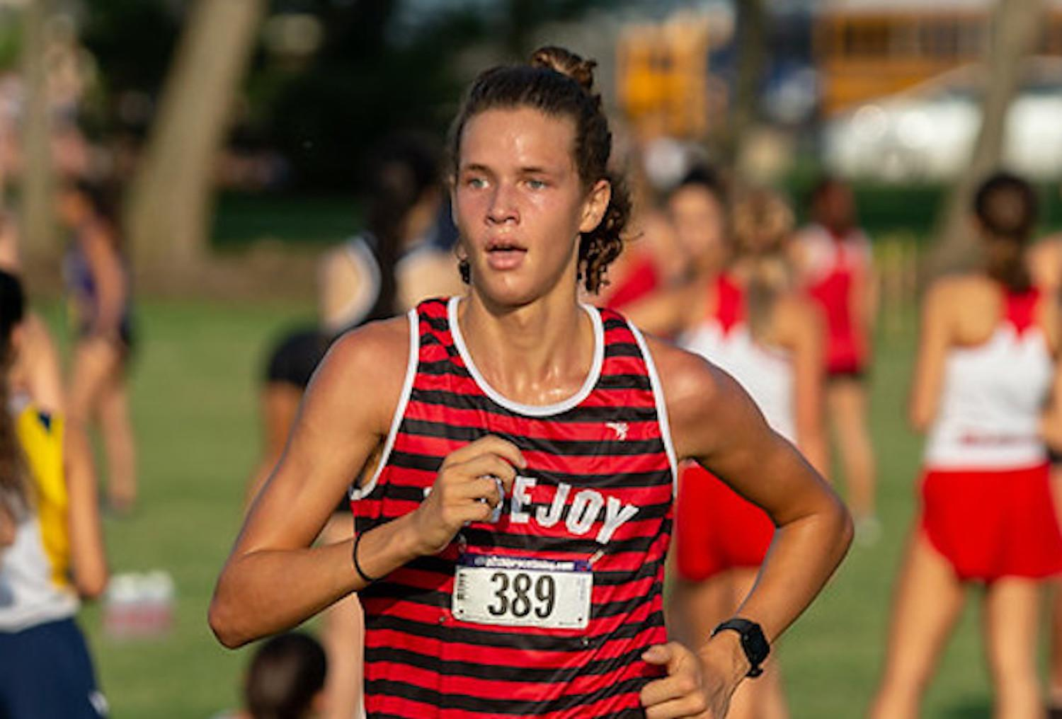 Junior Will Muirhead keeps a steady pace at the Plano ISD Invitational.