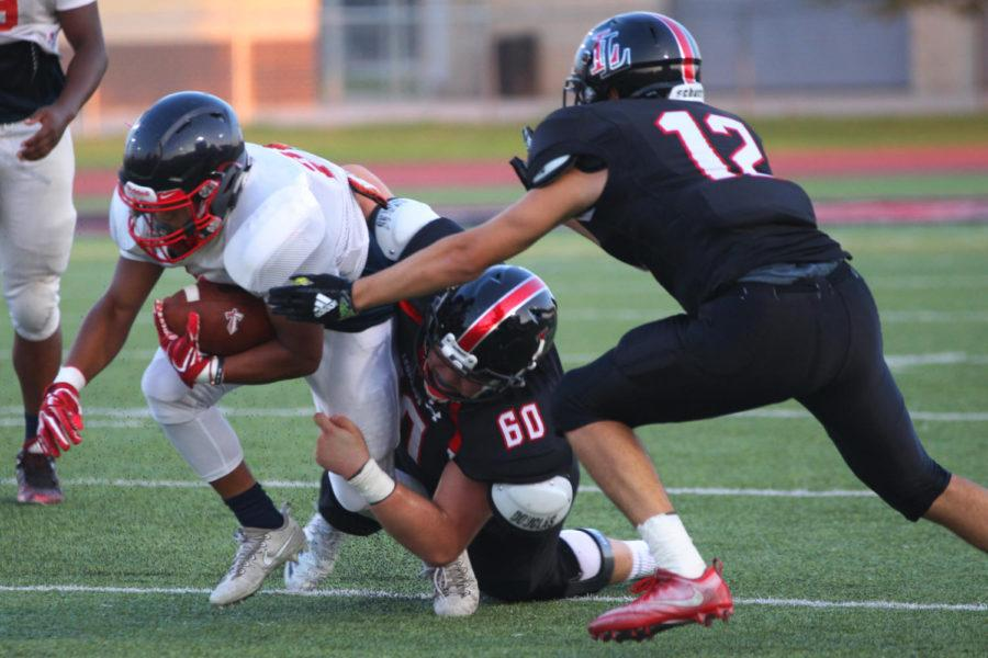 Senior+Beau+Iovinelli+and+Junior+Grant+Sessions+tackle+down+a+Frisco+Centennial+player.+