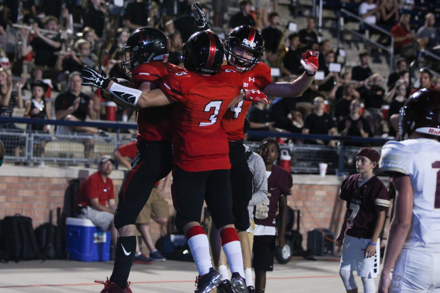 The+Leopards+offense+celebrates+one+of+its+six+touchdowns+in+a+42-26+victory+over+Frisco+Heritage.