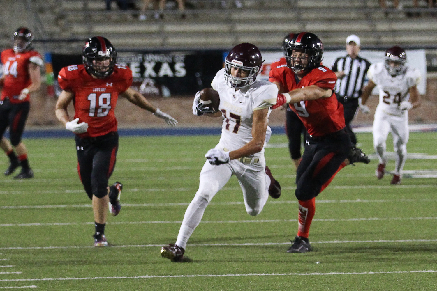 Seniors Ryan Collins and Danny Flaggert pursue a Frisco Heritage ball carrier.