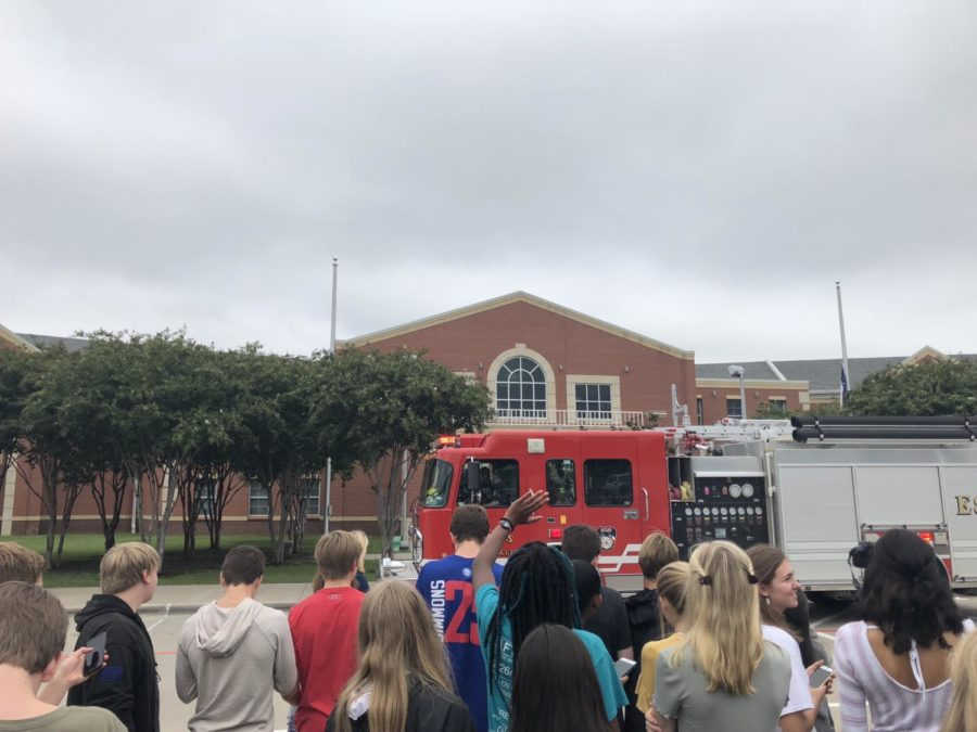 Firemen got suited up to enter the school, but they returned to the truck instead.