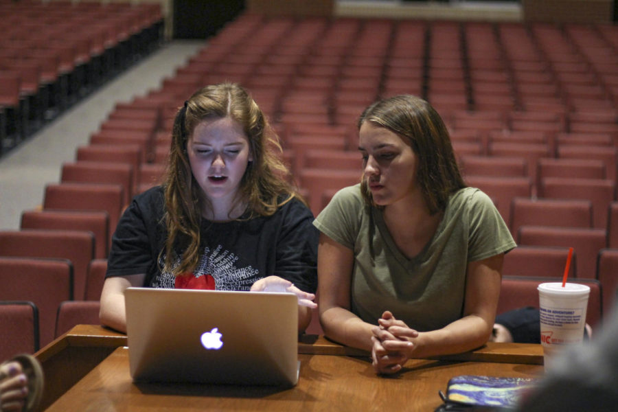 Senior Directors Natalie Edwards and Adelyn Maruca review the scene.