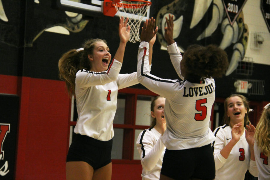 Senior Liana Guillemaud and junior Cecily Bramschreiber celebrate after a set against Wylie East.