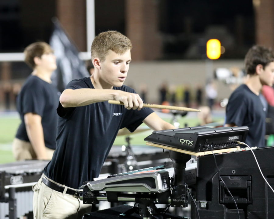 Junior+Matthew+Franks+performed+in+the+front+ensemble+during+the+Frisco+Heritage+football+game.