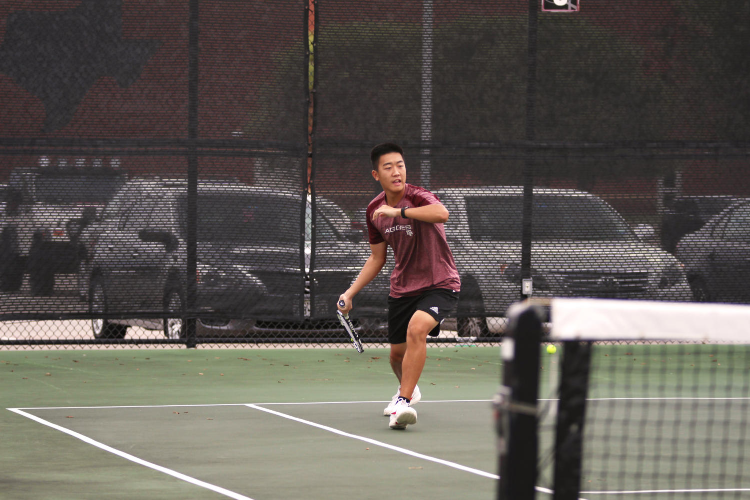 Senior Daniel Xue ranges across the court in attempts to continue the play.