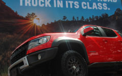 Located outside the Automobile building, the Truck Zone is an outdoor space featuring car models including Chevrolet.