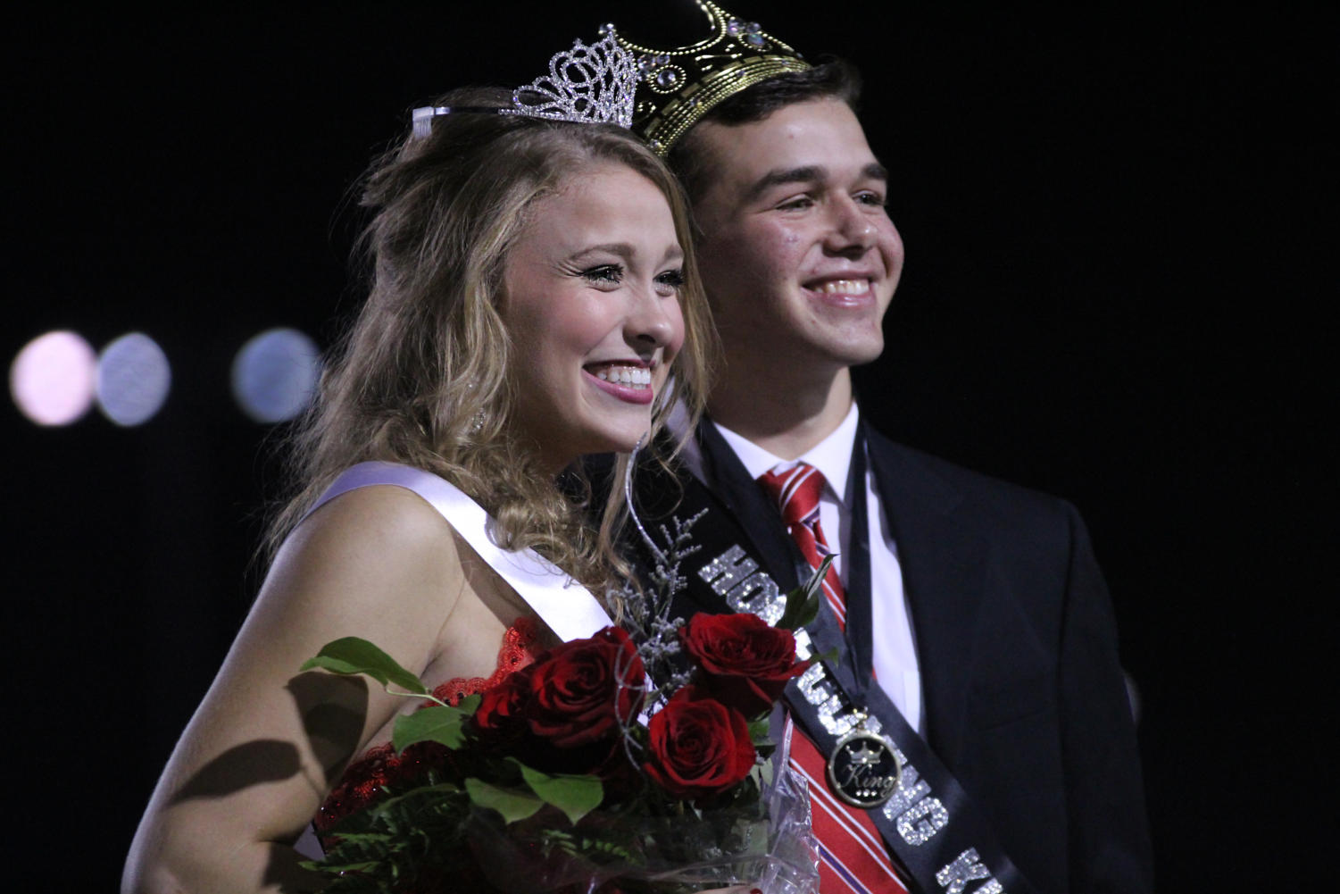 Homecoming+royalty+Sarah+Collins+and+Haydn+Spooner+pose+for+photos.