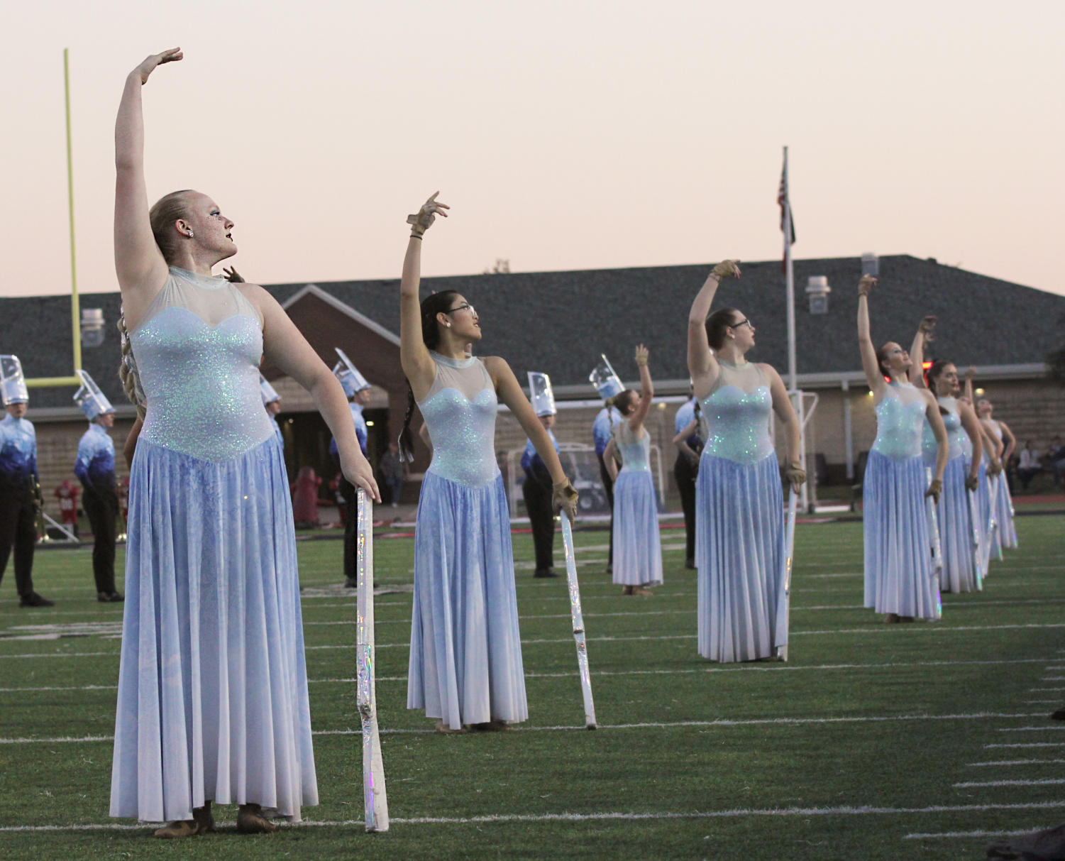 Colorguard+dancers+pose+at+the+end+of+their+performance.