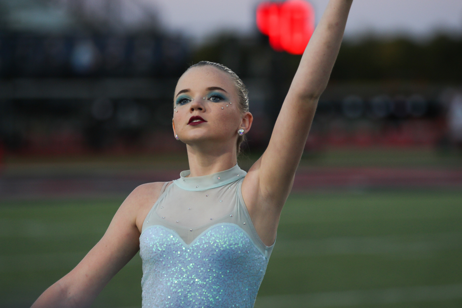 Freshman+Mackenzie+Miller+dances+with+the+color+guard+as+they+perform+with+the+band+before+the+football+game.+