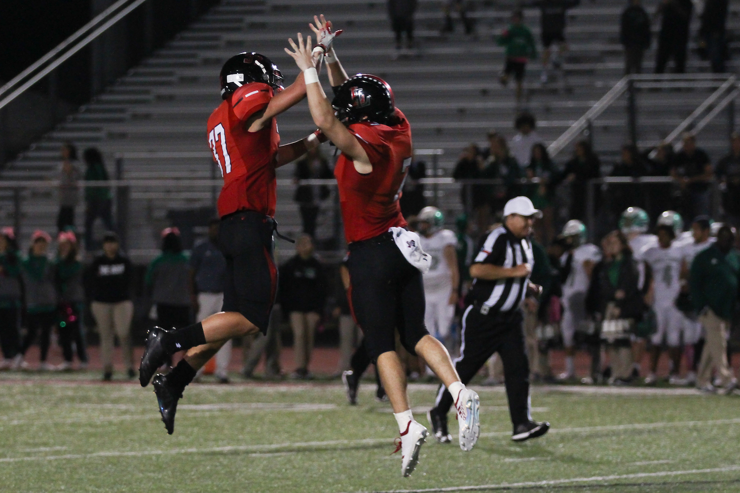 Defensive+back+Quinn+McDermott+and+quarterback+Carson+Collins+celebrate+after+a+touchdown.