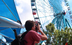 Junior Kelsey Carroll rides the Ferris wheel for the first time at the State Fair of Texas, despite long-time fears.