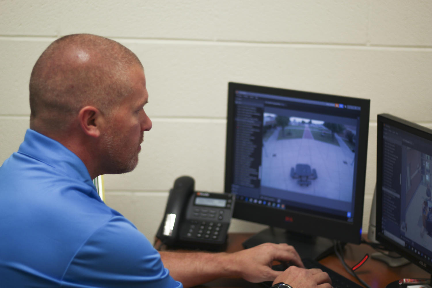 Campus security officer Casey Littlefield monitors the courtyard via security cameras.