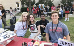 (Left to right) Jaden Lewis, Emma Davis, Peter Godipelly, and Jordan Yoder run the baking club booth at Leopard Friday.